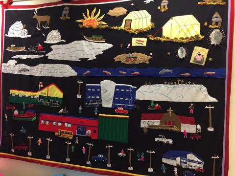 Igloolik community tapestry on display at the Ataguttaaluk High School in June 2017. The RCYO spent time meeting with a variety of child and youth service providers.